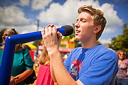 "03 SEPTEMBER 2011 - ST. PAUL, MN: A fair goer participates in a sing-along at the Minnesota State Fair, Sept. 3. The Minnesota State Fair is one of the largest state fairs in the United States. It's called ""the Great Minnesota Get Together"" and includes numerous agricultural exhibits, a vast midway with rides and games, horse shows and rodeos. Nearly two million people a year visit the fair, which is located in St. Paul.   PHOTO BY JACK KURTZ"