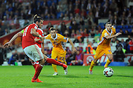 Gareth Bale scores from the penalty spot for his second and Wales' 4th goal against Moldova. Wales v Moldova , FIFA World Cup qualifier at the Cardiff city Stadium in Cardiff on Monday 5th Sept 2016. pic by Carl Robertson, Andrew Orchard sports photography
