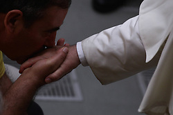 August 1,  2018  - Vatican City - POPE FRANCIS receives a kiss on the hand during his weekly general audience in Aula Paolo VI at the Vatican. (Credit Image: © Evandro Inetti via ZUMA Wire)