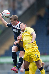 Falkirk's Stephen Kingsley and Queen of the South's Derek Lyle.<br /> Half time : Falkirk 0 v 0 Queen of the South, Scottish Championship game today at the Falkirk Stadium.<br /> © Michael Schofield.