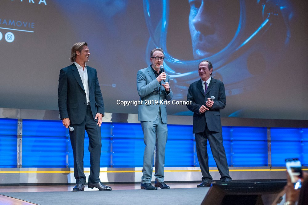 """WASHINGTON DC: Actor Brad Pitt, director James Gray and actor Tommy Lee Jones attend 20th Century Fox's and New Regencies special screening of """"AD ASTRA """" movie at the National Geographic Museum  on September 16, 2019 in Washington DC. A paranoid thriller in space that follows Roy McBride (Brad Pitt) on a mission across an unforgiving solar system to uncover the truth about his missing father and his doomed expedition that now, 30 years later, threatens the universe. (Photo by Kris Connor/20th Century Fox)"""