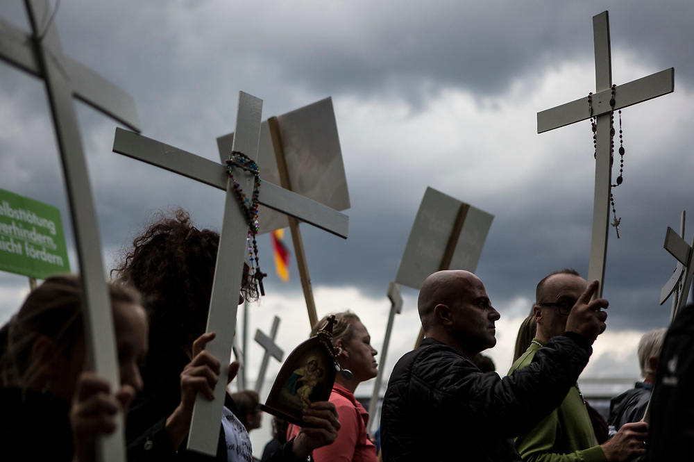 "Participants in ""The March For Life"" are seen carrying crosses as they march through Berlin's Mitte district, on September 16, 2017. In the center of the pro-life event was the call by the organizers for German politicians and society to take active action against a ""silent increase of acceptance"" of the phenomenon. Abortion in Germany is permitted in the first trimester of the pregnancy, with the condition of mandatory counseling and in a later period of the pregnancy in cases of medical necessity.<br /> (Photo by Omer Messinger)"