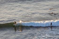 Surfers At Papua Gulch