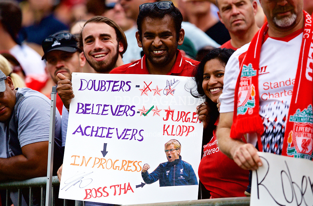 CHARLOTTE, USA - Sunday, July 22, 2018: A Liverpool supporter with a sign featuring manager Jürgen Klopp during a preseason International Champions Cup match between Borussia Dortmund and Liverpool FC at the  Bank of America Stadium. (Pic by David Rawcliffe/Propaganda)