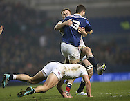 James Chisholm (Harlequins) tackles Eliott Roudil during the 2015 Under 20s 6 Nations match between England and France at the American Express Community Stadium, Brighton and Hove, England on 20 March 2015.