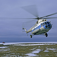 TAYMYR PENINSULA, RUSSIA. Helicopter lands beside Arctic Ocean near northernmost point of continental Asia.