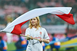 Wroclaw, Poland - 2016 November 14: Girl holds Polish flag before Poland v Slovenia - International Friendly Soccer Match at Municipal Stadium on November 14, 2016 in Wroclaw, Poland.<br /> <br /> Adam Nurkiewicz declares that he has no rights to the image of people at the photographs of his authorship.<br /> <br /> Picture also available in RAW (NEF) or TIFF format on special request.<br /> <br /> Any editorial, commercial or promotional use requires written permission from the author of image.<br /> <br /> Mandatory credit:<br /> Photo by © Adam Nurkiewicz / Mediasport