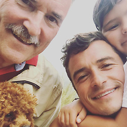 """Orlando Bloom releases a photo on Instagram with the following caption: """"3 generations and a mighty right there\ud83d\ude4f\ud83c\udffb\ud83d\ude4c\ud83c\udffb\ud83d\udc4a\ud83c\udffb"""". Photo Credit: Instagram *** No USA Distribution *** For Editorial Use Only *** Not to be Published in Books or Photo Books ***  Please note: Fees charged by the agency are for the agency's services only, and do not, nor are they intended to, convey to the user any ownership of Copyright or License in the material. The agency does not claim any ownership including but not limited to Copyright or License in the attached material. By publishing this material you expressly agree to indemnify and to hold the agency and its directors, shareholders and employees harmless from any loss, claims, damages, demands, expenses (including legal fees), or any causes of action or allegation against the agency arising out of or connected in any way with publication of the material."""
