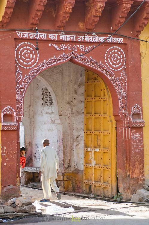 A man walking through a gate in Jodhpur, Rajasthan, India