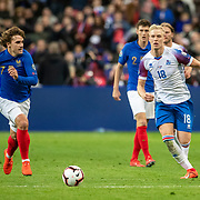 PARIS, FRANCE - March 25:  Hordur Bjorgvin Magnusson #18 of Iceland defended by Antoine Griezmann #7 of France during the France V Iceland, 2020 European Championship Qualifying, Group Stage at  Stade de France on March 25th 2019 in Paris, France (Photo by Tim Clayton/Corbis via Getty Images)