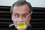 Anti Brexit pro Europe protest face mask of Nigel Farage on 12th December 2018 in London, England, United Kingdom.