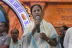 October 10, 2018 - Kolkata, West Bengal, India - Chief Minister Mamata Banerjee address during the inauguration Ekdalia Evergreen Club Durga Puja festival. West Bengal Chief Minister Mamata Banerjee inaugurates Ekdalia Evergreen Club Durga Puja festival pandal or temporary platform. The annual five days festival begins on October 15 and worship Goddess Durga who symbolized power and the triumph of good over evil in Hindu mythology. (Credit Image: © Saikat Paul/Pacific Press via ZUMA Wire)