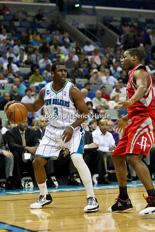 April 6, 2011; New Orleans, LA, USA; New Orleans Hornets point guard Chris Paul (3) is guarded by Houston Rockets point guard Kyle Lowry (7) during the first half at the New Orleans Arena.   Mandatory Credit: Derick E. Hingle-US PRESSWIRE