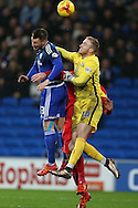 Jason Steele, the Blackburn Rovers goalkeeper punches clear to deny Anthony Pilkington of Cardiff city (l). Skybet football league championship match, Cardiff city v Blackburn Rovers at the Cardiff city stadium in Cardiff, South Wales on Saturday 2nd Jan 2016.<br /> pic by Andrew Orchard, Andrew Orchard sports photography.