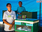 07 AUGUST 2016 - BANGKOK, THAILAND:  An election worker stands next to a ballot box in a polling place in Bangkok. Thais voted Sunday in the referendum to approve a new charter (constitution) for Thailand. The new charter was written by a government appointed panel after the military coup that deposed the elected civilian government in May, 2014. The charter referendum is the first country wide election since the coup.      PHOTO BY JACK KURTZ