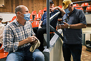 """22 SEPTEMBER 2020 - DUNLAP, IOWA: Congressional candidate J.D. SCHOLTEN watches a cattle auction at Dunlap Livestock Auction. Scholten talked to people at the auction about farm policy and anti-trust legislation for the livestock industry. Scholten, a Democrat from Sioux City, Iowa, ran against incumbent CongressmanSteve King (R-4th District Iowa) in 2018 and came within a few percentage points of upsetting the long serving conservative. King lost to Randy Feenstra, a Republican challenger, in the 2020 primary and Scholten is running against Feenstra in the 2020 general election on November 3. Iowa's 4th district, centered in the agricultural and sparsely populated northwest corner of the state, is the largest congressional district in Iowa and encompasses about ⅓ of the state of Iowa. Scholten is on his """"Every Town Tour 2020."""" He is visiting all 375 towns in the 39 counties in the district.    PHOTO BY JACK KURTZ"""