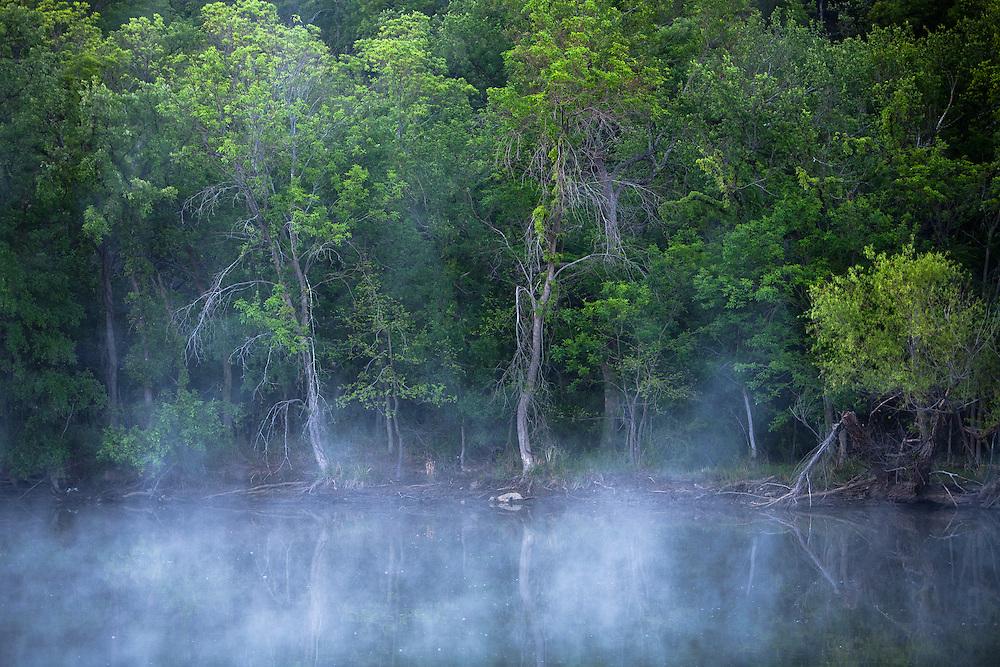 Fog lifts on a creek near Oran, Texas.