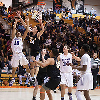 Jacob Moon (10) drives to the basket for Clovis but is blocked by Jalen Young (34) for Hobbs at the 75th Annual Gallup Boys Invitational Basketball Tournament Championship game, Saturday, Jan. 5, 2019 at Gallup High School.