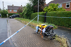 © Licensed to London News Pictures. 21/06/2021. Burnham, UK. An ambulance stretcher and equipment at the scene following the death of a man in Wyndham Crescent in Burnham on Monday 20/06/2021. Emergency services were called at approximately 13:10BST to the Buckinghamshire street following reports of an altercation involving a group of men. Shortly after this a 35-year-old man collapsed. Thames Valley Police officers and paramedics attended the scene and performed CPR on the man but he was later pronounced dead. Photo credit: Peter Manning/LNP
