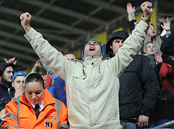 Cardiff City fan celebrates the win over cardiff. - Photo mandatory by-line: Alex James/JMP - Tel: Mobile: 07966 386802 03/11/2013 - SPORT - FOOTBALL - The Cardiff City Stadium - Cardiff - Cardiff City v Swansea City - Barclays Premier League