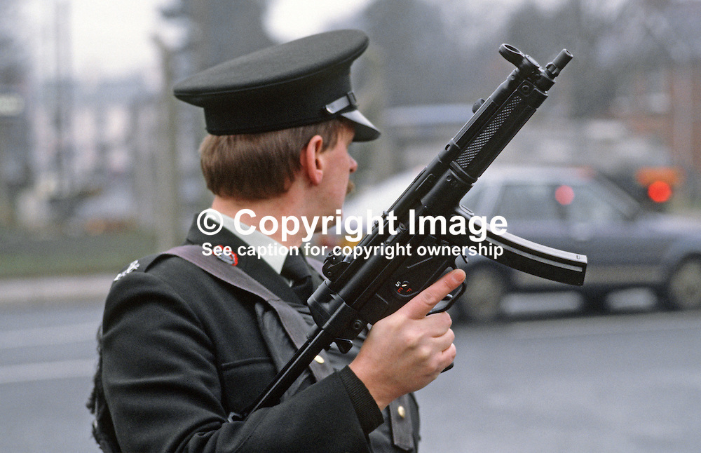 RUC officer displays the Heckler & Koch MP5 machine gun which just been issued to the N Ireland police force. January 1985. 19850004b.<br /> <br /> Copyright Image from Victor Patterson, Belfast, UK<br /> <br /> t: +44 28 9066 1296 (from Rep of Ireland 048 9066 1296)<br /> m: +44 7802 353836<br /> e: victorpattersonbelfast@gmail.com<br /> <br /> www.images4media.com<br /> <br /> Please see my full Terms and Conditions of Use at https://www.images4media.com/p/terms-conditions - it is IMPORTANT that you familiarise yourself with them.<br /> <br /> Images used online incur an additional cost. This cost should be agreed in writing in advance. Online images must be visibly watermarked i.e. © Victor Patterson or that of the named photographer within the body of the image. The original metadata must not be deleted from images used online.<br /> <br /> This image is only available for the use of the download recipient i.e. television station, newspaper, magazine, book publisher, etc, and must not be passed on to a third party. It is also downloaded on condition that each and every usage is notified within 7 days to victorpattersonbelfast@gmail.com.<br /> <br /> The right of Victor Patterson (or the named photographer) to be identified as the author is asserted in accordance with The Copyright Designs And Patents Act (1988). All moral rights are asserted.