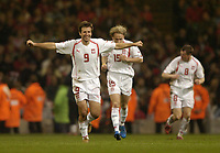 Fotball<br /> VM-kvalifisering<br /> Wales v Polen<br /> 13.10.2004<br /> Foto: SBI/Digitalsport<br /> NORWAY ONLY<br /> <br /> Wales v Poland. FIFA World Cup European Qualifying Group Six. Millenium Stadium. 13/10/2004.<br /> <br /> Maciej Zurawski celebrates scoring Poland's second goal.