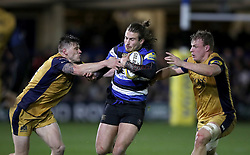 Bath's Max Clark breaks through the Bristol defence