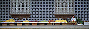 MEXICO, GULF COAST, VERACRUZ Coatepec, near Jalapa, colonial style building with tile facade and a street vendor selling fruit