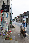 "Man pushes an awkward load on his bicycle in Hay-on-Wye or Y Gelli Gandryll in Welsh, known as ""the town of books"", is a small town in Powys, Wales famous for it's many second hand and specialist bookshops, although the number has declined sharply in recent years, many becoming general antique shops and similar."
