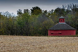 Round Barn stands alone in a field near Cayuga Indiana