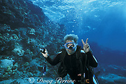 Jerry Garcia, late guitarist of the Grateful Dead, flashes the peace sign while scuba diving in Kona, Hawaii, USA (where he learned to dive, and one of his favorite vacation spots)