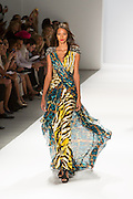 Gown in yellow cream and black animal print with a turquoise black and gold gauzy train and silver brocase epaulets. By Carlos Miele at the Spring 2013 Mercedes-Benz Fashion Week in New York.