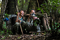Two of our guides enjoy looking at images from the day, Wuliangshan Nature Reserve, Mount Wuliang Nature Reserve in Jingdong county, Yunnan, China.