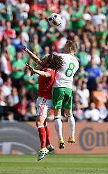 Joe Allen of Wales battles for the high ball with, Steven Davis of Northern Ireland  - Mandatory by-line: Joe Meredith/JMP - 25/06/2016 - FOOTBALL - Parc des Princes - Paris, France - Wales v Northern Ireland - UEFA European Championship Round of 16