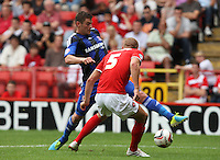 Middlesbrough's Lukas Jutkiewicz takes on Charlton Athletic's Michael Morrison<br /> (Photo by Kieran Galvin/CameraSport)<br /> <br /> Football - The Football League Sky Bet Championship - Charlton Athletic v Middlesbrough - Saturday 10th August 2013 - The Valley - London<br /> <br /> © CameraSport - 43 Linden Ave. Countesthorpe. Leicester. England. LE8 5PG - Tel: +44 (0) 116 277 4147 - admin@camerasport.com - www.camerasport.com