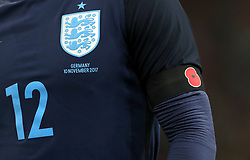 Detail of the arm of England's Kyle Walker with a poppy on his armband