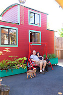 Kol Peterson and Deb Delman, owners of the Caravan Tiny House Hotel, outside the tiny house called The Caboose, Portland, OR, USA