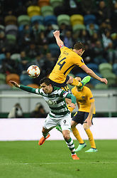 LISBON, April 13, 2018  Marcos Acuna (Down) of Sporting vies with Gabi of Atletico during the Europa League quarterfinal second leg soccer match between Sporting CP and Club Atletico de Madrid at the Jose Alvalade stadium in Lisbon, Portugal, on April 12, 2018. Sporting won 1-0 but was eliminated by a 1-2 aggregate. (Credit Image: © Zhang Yadong/Xinhua via ZUMA Wire)