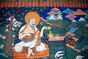 A painting in traditional Bhutanese style shows a benevolent contemplative sage. The picture is full of allegorical meaning and auspicious Buddhist symbolism relating to a long life, the six symbols of longevity. It originates in Chinese and Tibetan buddhist art. Paro Dzong, Druk Yul,  Bhutan. 10 November 2007