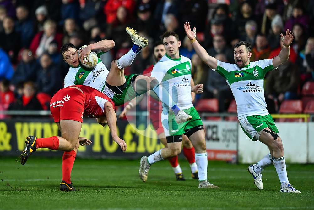 11th November 2018 , Racecourse Ground,  Wrexham, Wales ;  Rugby League World Cup Qualifier,Wales v Ireland ; Scott Grix of Ireland is tackled in the air by Ben Morris of Wales <br /> <br /> <br /> Credit:   Craig Thomas/Replay Images
