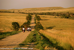 """Riding the Back Roads, East of Sturgis, SD, 1995<br /> <br /> Limited Edition Print from an edition of 50. Photo ©1995 Michael Lichter.<br /> <br /> The Story: After I finished shooting a pictorial on some Don Hotop bikes, he and his friends set off for Sturgis.  I imagine crossing America looked this way when Harley was a young company and the word """"travel"""" was synonymous with adventure."""