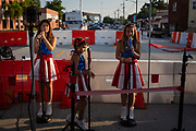 """(From L) """"USA Freedom Kids"""" Alexis, 9, Bianca, 11, and Melaina, 11, rehearse in the media staging area near the crime scene at Pulse nightclub where a gunman killed 49 and injured 53 others in an attack on the LGBTQ community, in Orlando, Florida, U.S. The singing girls, made famous by their performance at a Donald Trump presidential campaign rally, were brought to Orlando by manager Jeff Popick in hopes of singing the national anthem on a news broadcast near the site of the recent mass shooting."""