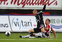 Fotball<br /> Tippeliga 2011<br /> Tromsø - Odd 25.04.2011<br /> Mattias Andersson, Odd<br /> Tore Reginiussen, Tromsø<br /> Foto: Tom Benjaminsen, Digitalsport