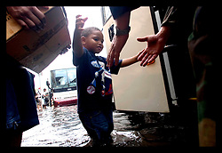 1st Sept, 2005. Mass evacuation of New Orleans begins. A little boy boards the first bus convoy out of New Orleans.