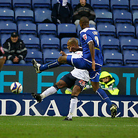 Photo: Steve Bond/Sportsbeat Images.<br /> Leicester City v West Bromwich Albion. Coca Cola Championship. 08/12/2007. Pedro Pele (back) clears under pressure from Carl Cort (front)