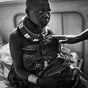 9 month old malnutritioned infant,  Emoni Lokiriba seen in the arms of his mother, 23 year old Akaale Ekata at the stabilization centre of the Lokitaung District Hospital in the Turkana region of northwestern Kenya. Photo: Sanjit Das/Panos