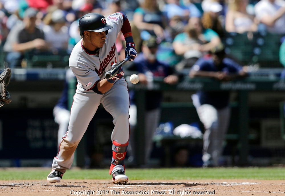 Minnesota Twins' Jorge Polanco bunts for an RBI single against the Seattle Mariners during the fifth inning of a baseball game, Sunday, May 19, 2019, in Seattle. (AP Photo/John Froschauer)