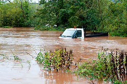 © Licensed to London News Pictures. 26/10/2019. Crickhowell, Powys, Wales, UK. A truck is engulfed by flood water as rain falls relentlessly and the level of the river Usk rises dramatically. Water enters The Bridge End Inn basement in Bridge Street, Crickhowell  in Powys. Photo credit: Graham M. Lawrence/LNP