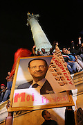 """Rally for the winner of the French Presidential elections, incoming President Francois Hollande of the Socialist Party at the Bastille, Paris, on Sunday night May 7th 2012. Francois Hollande beat Nicolas Sarkozy 52% to 48% in the second and final round of the French Presidential Elections///Socialist Party supporters holding a portrait of Francois Hollande reading """"Moi President"""",  in the background the July Column """"Colonne de Juillet"""""""
