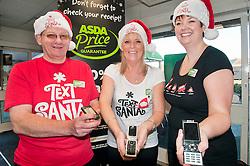 Text Santa  Charity Campaign Launch People Manager Sue Stringer with Asda collueuages John Somerville (left) and Jess Langan (right) Barrow Road Asda Harrogate. .www.pauldaviddrabble.co.uk.6 December 2011  Image © Paul David Drabble